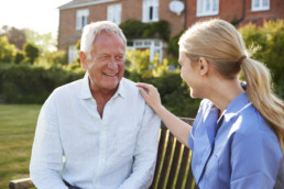 nurse-talking-to-senior-man-in-residential-